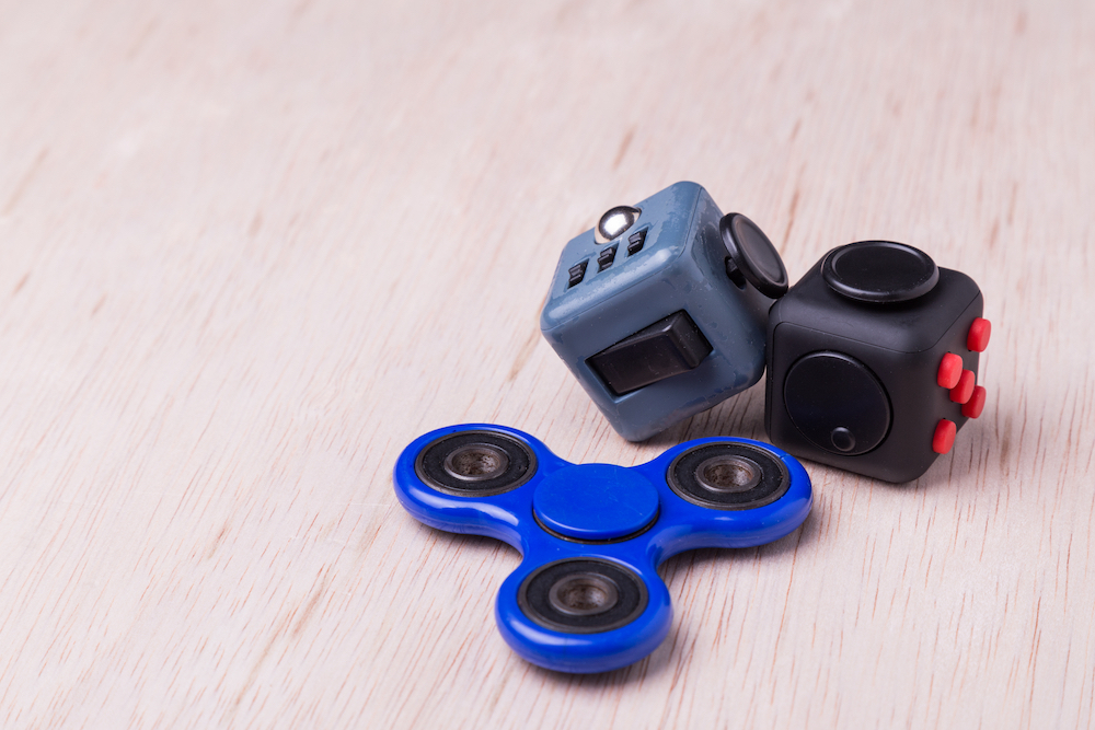 Fidget spinner and fidget cubes. Research suggests that intentional fidgeting may be a useful coping mechanism for anxiety and offer other health benefits as well.